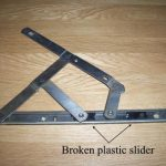 Broken window hinges showing a broken plastic slider Bexleyheath