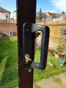 Black plastic patio door handle