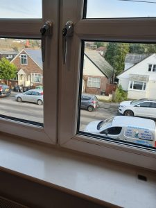 Double glazing upgrades to tilt & turn windows with chrome handles