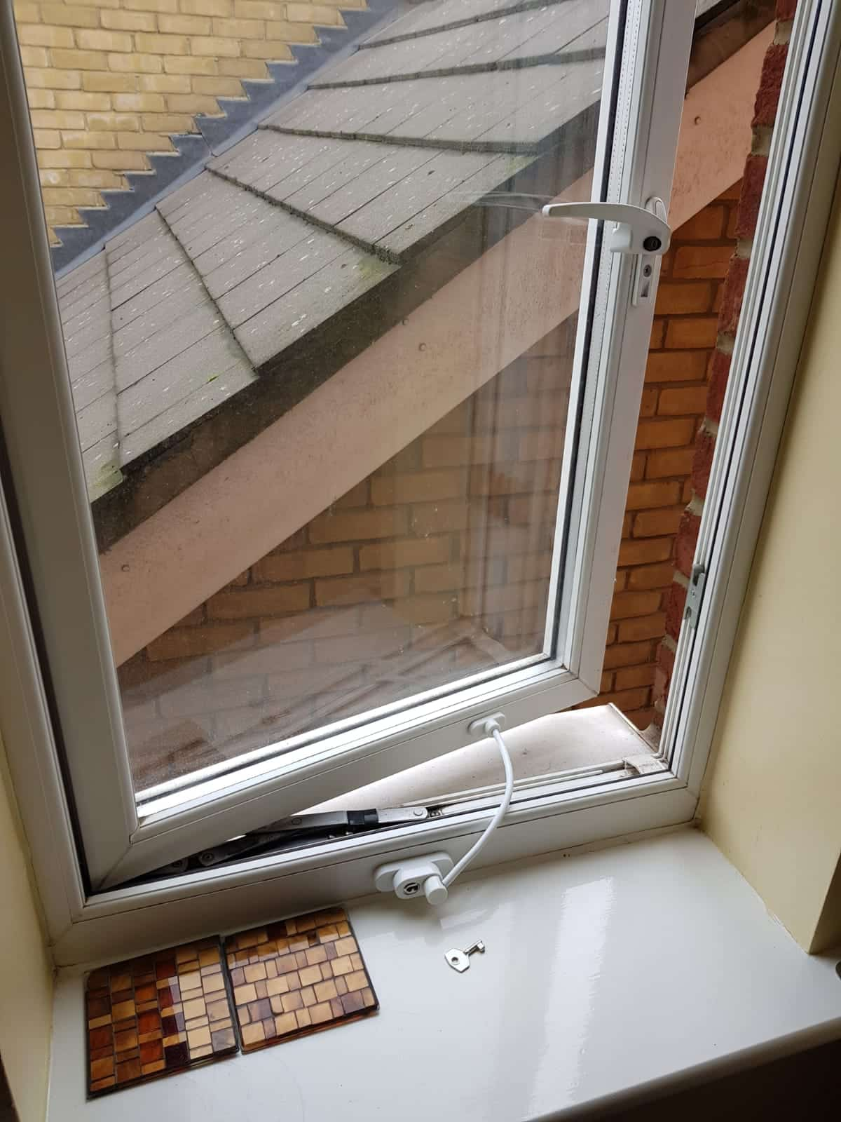Child safety window catch fitted after photograph